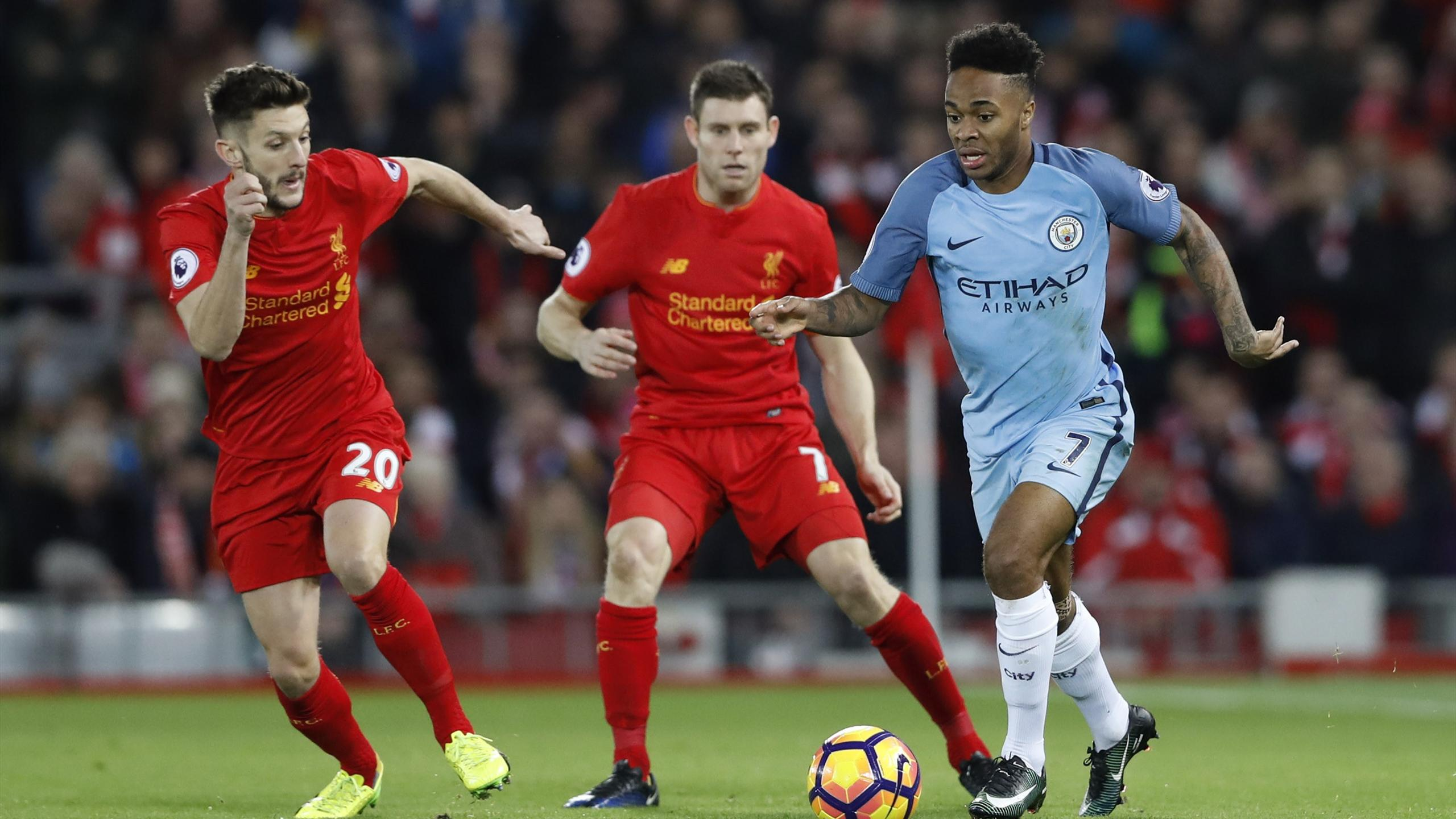 Raheem Sterling in action with Liverpool's James Milner and Adam Lallana