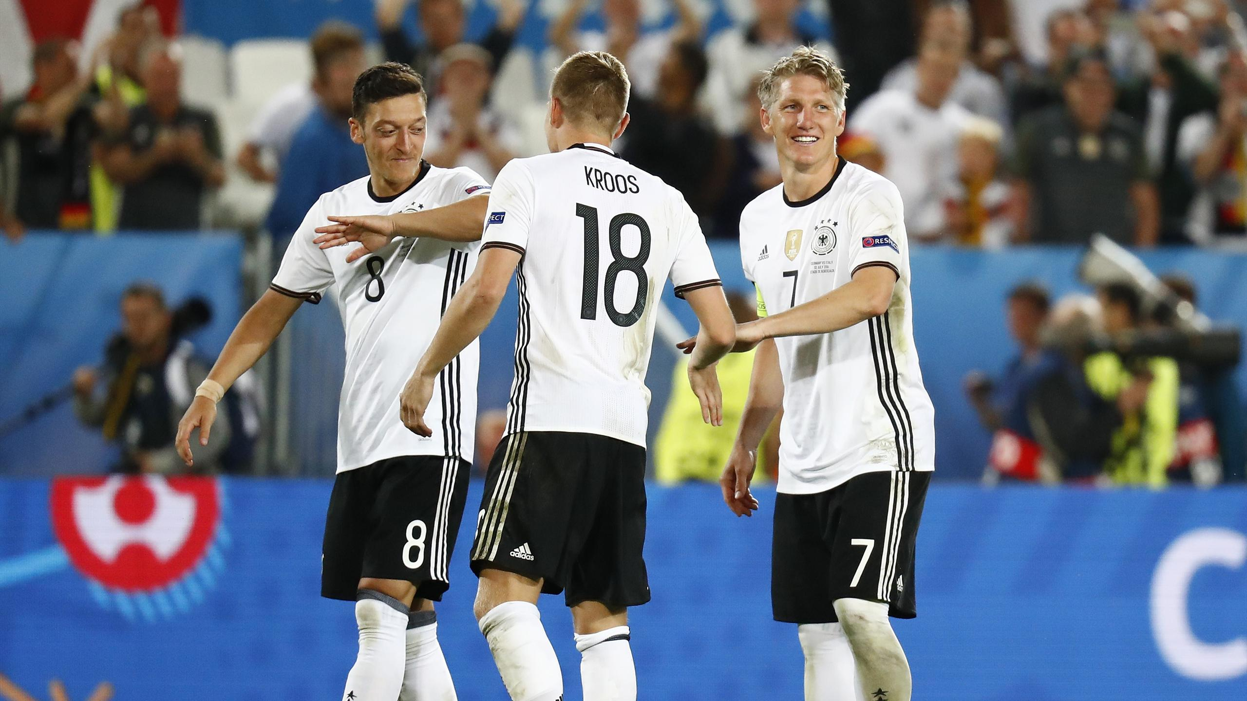 Toni Kroos is congratulated by Mesut Ozil and Bastian Schweinsteiger