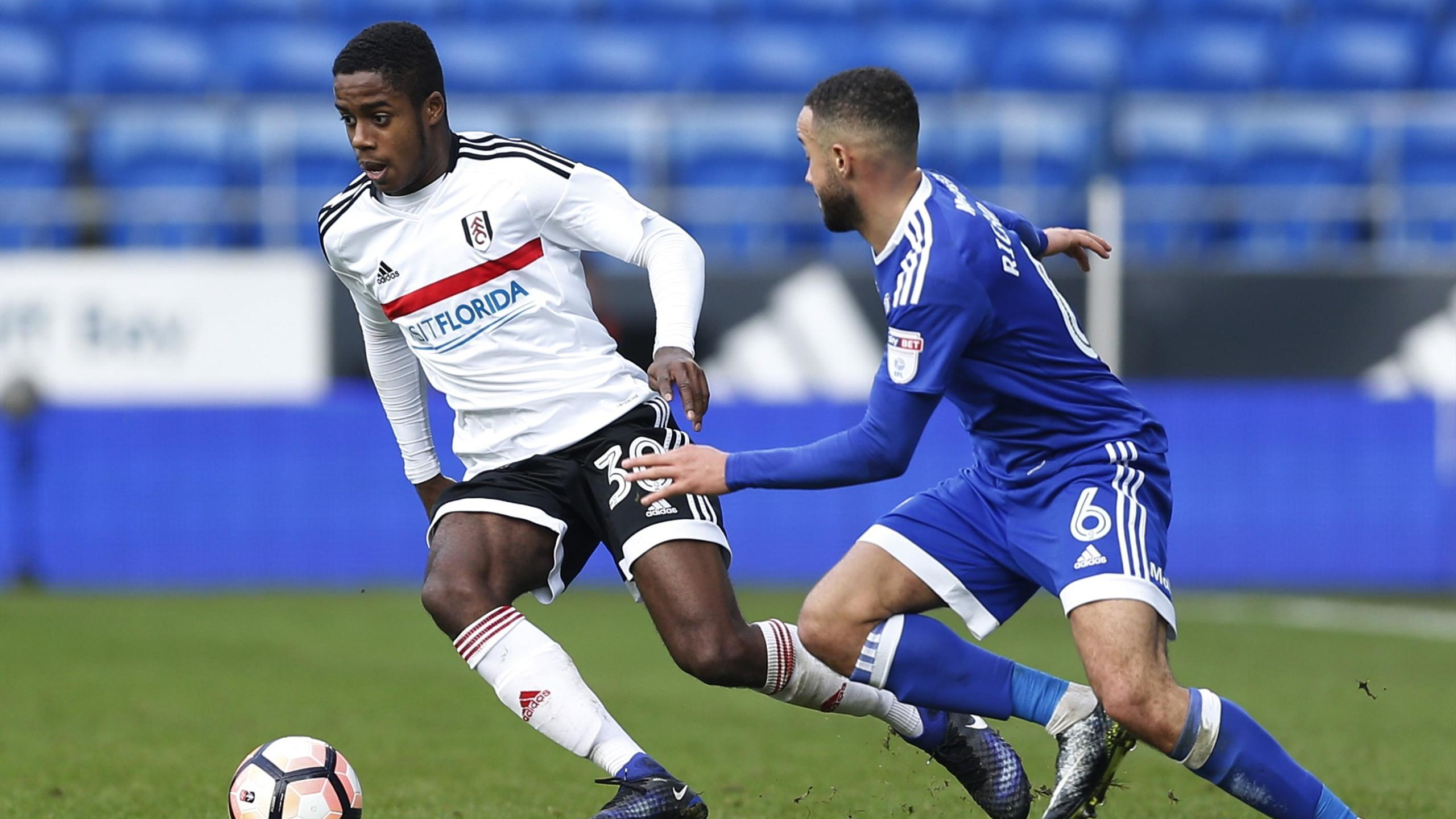 Cardiff City's Jazz Richards and Fulham's Ryan Sessegnon in action