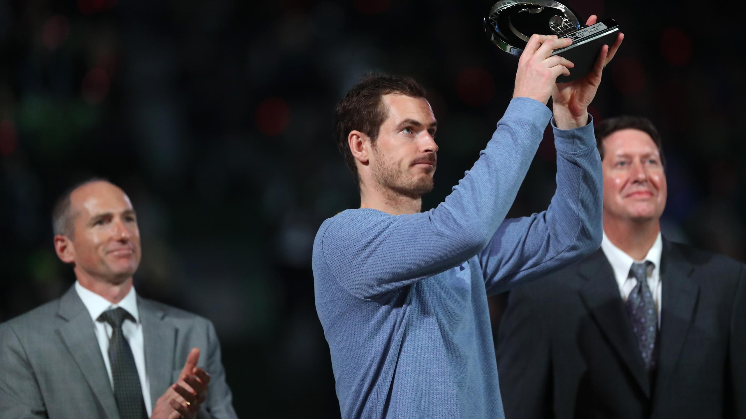 Britain's Andy Murray poses with his trophy after losing against Serbia's Novak Djokovic