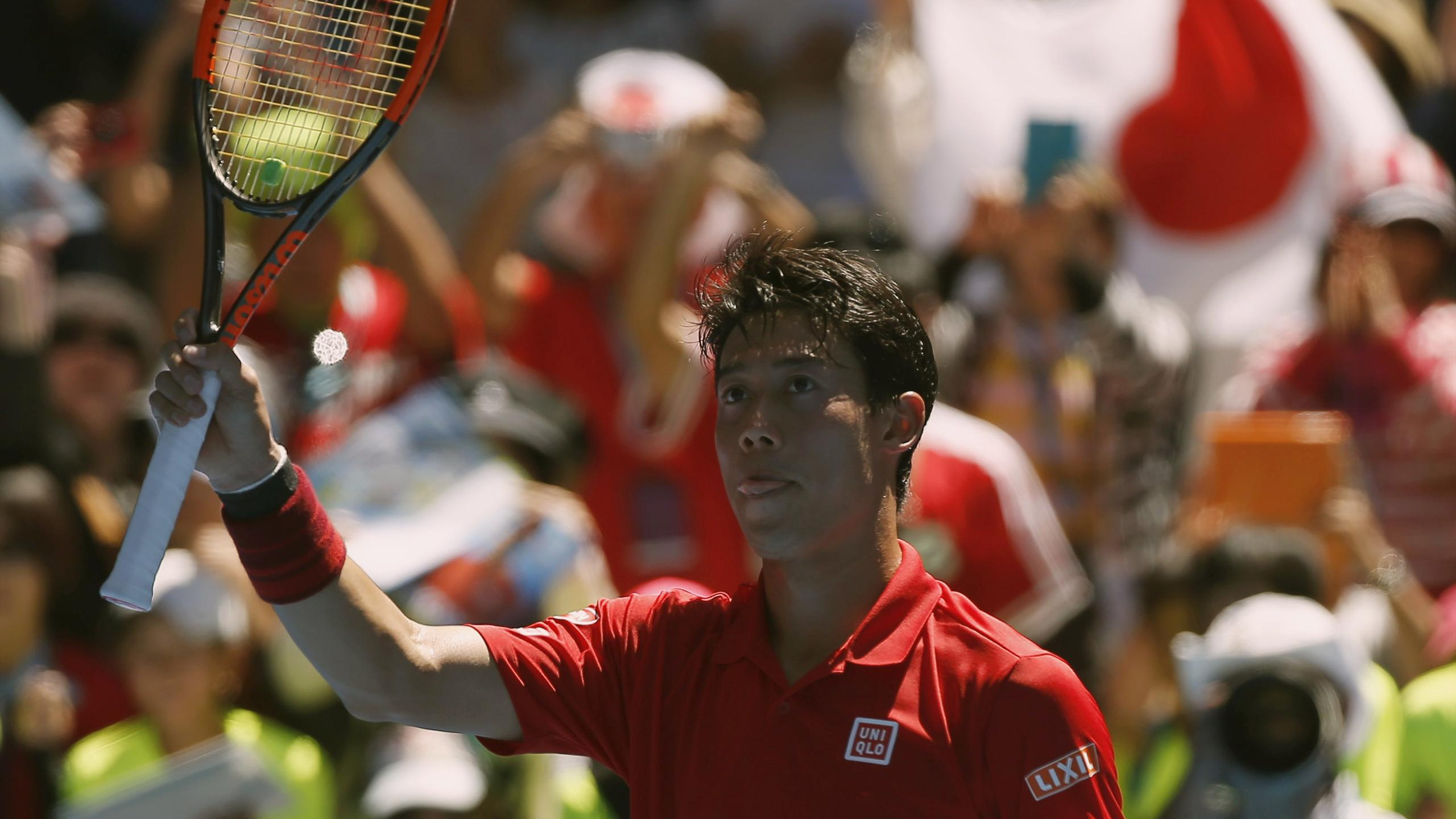 Japan's Kei Nishikori celebrates after winning his Men's singles first round match against Russia's Andrey Kuznetsov