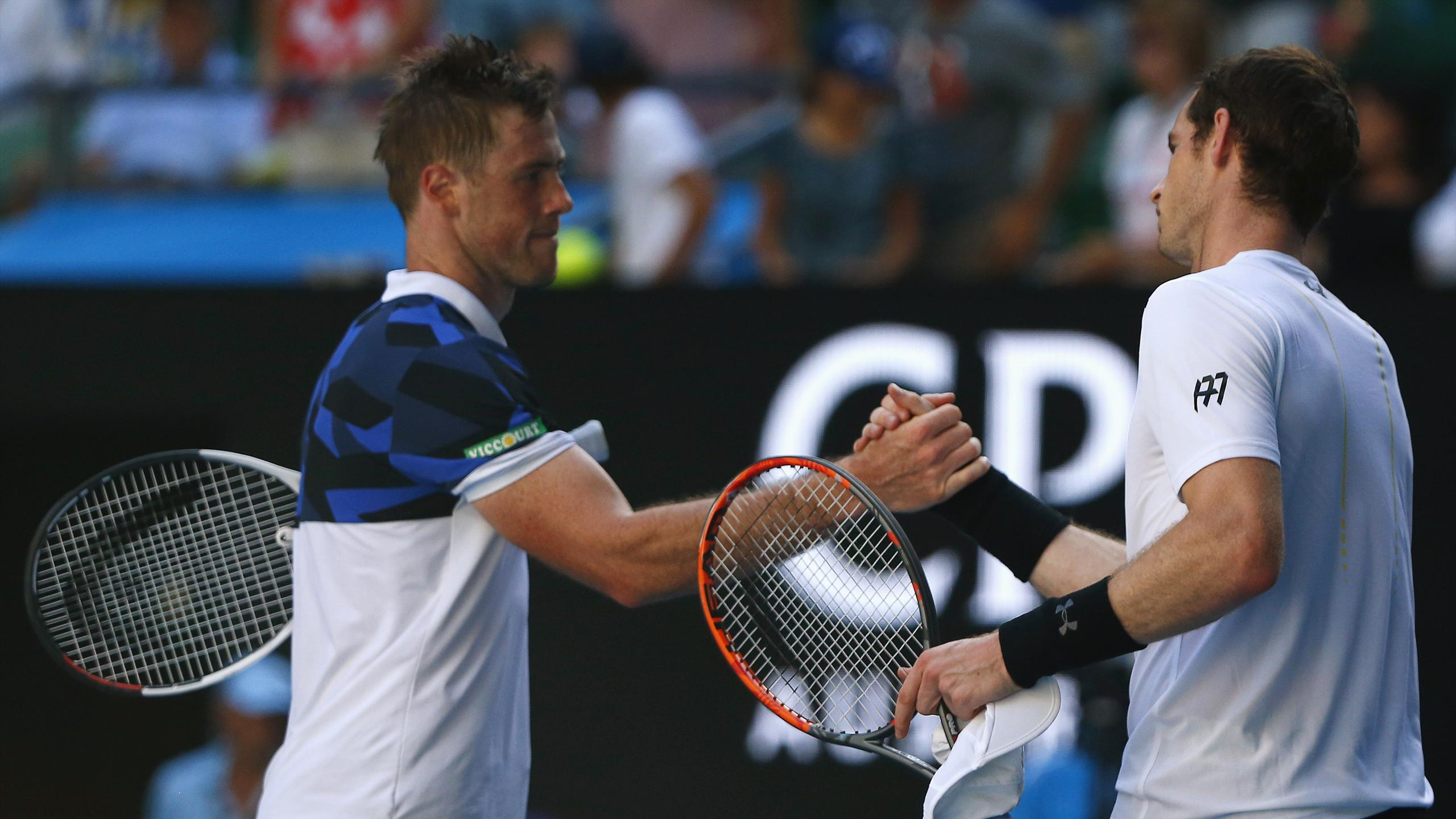 Britain's Andy Murray (R) shakes hands after winning his Men's singles first round match against Ukraine's Illya Marchenko