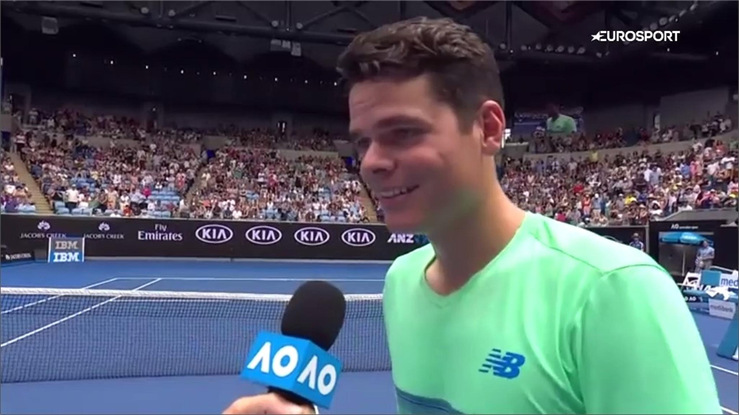 Milos Raonic jokes during his post-match interview