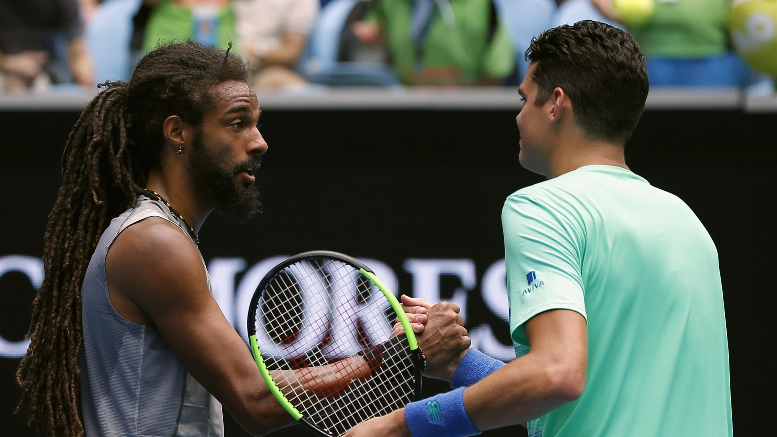 Canada's Milos Raonic shakes hands after winning his first round match against Germany's Dustin Brown