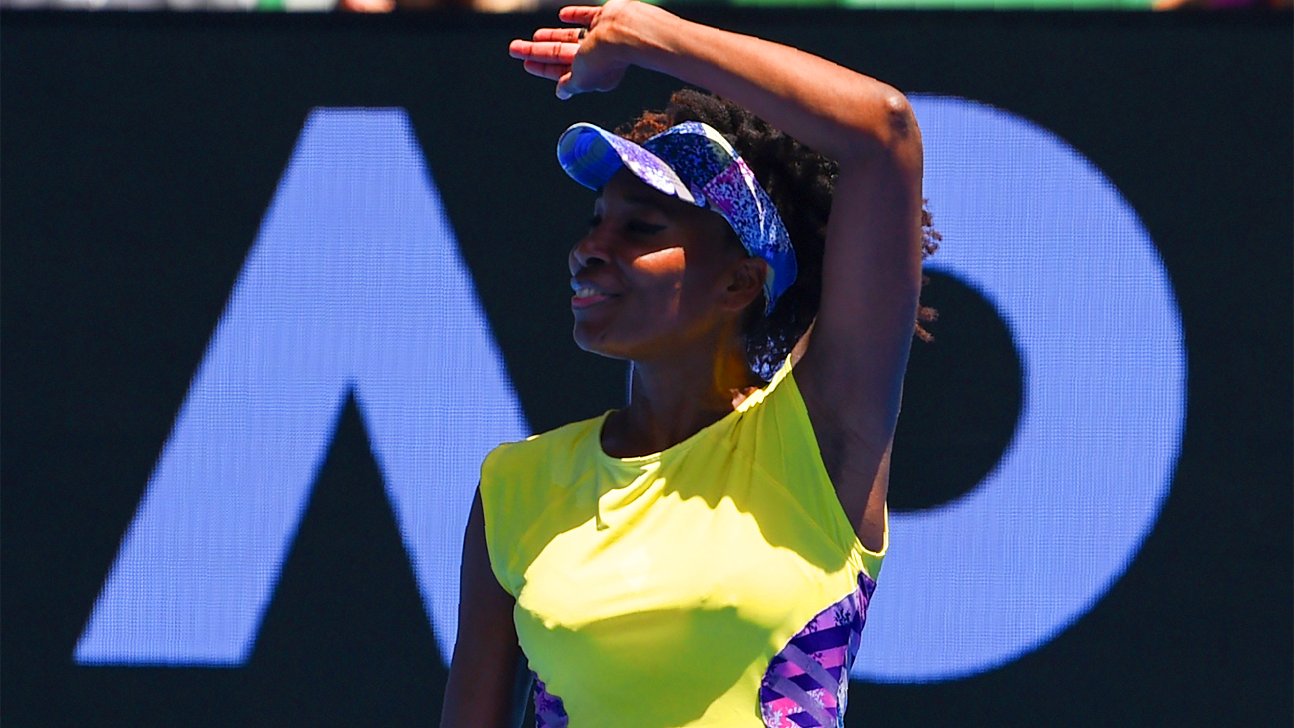 Venus Williams of the US celebrates after victory against Switzerland's Stefanie Voegele during their women's singles match on day three of the Australian Open