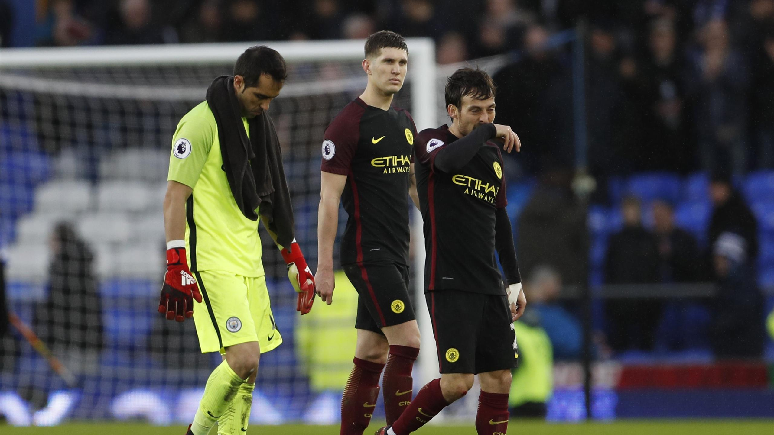 Manchester City's Claudio Bravo, John Stones and David Silva look dejected after the game