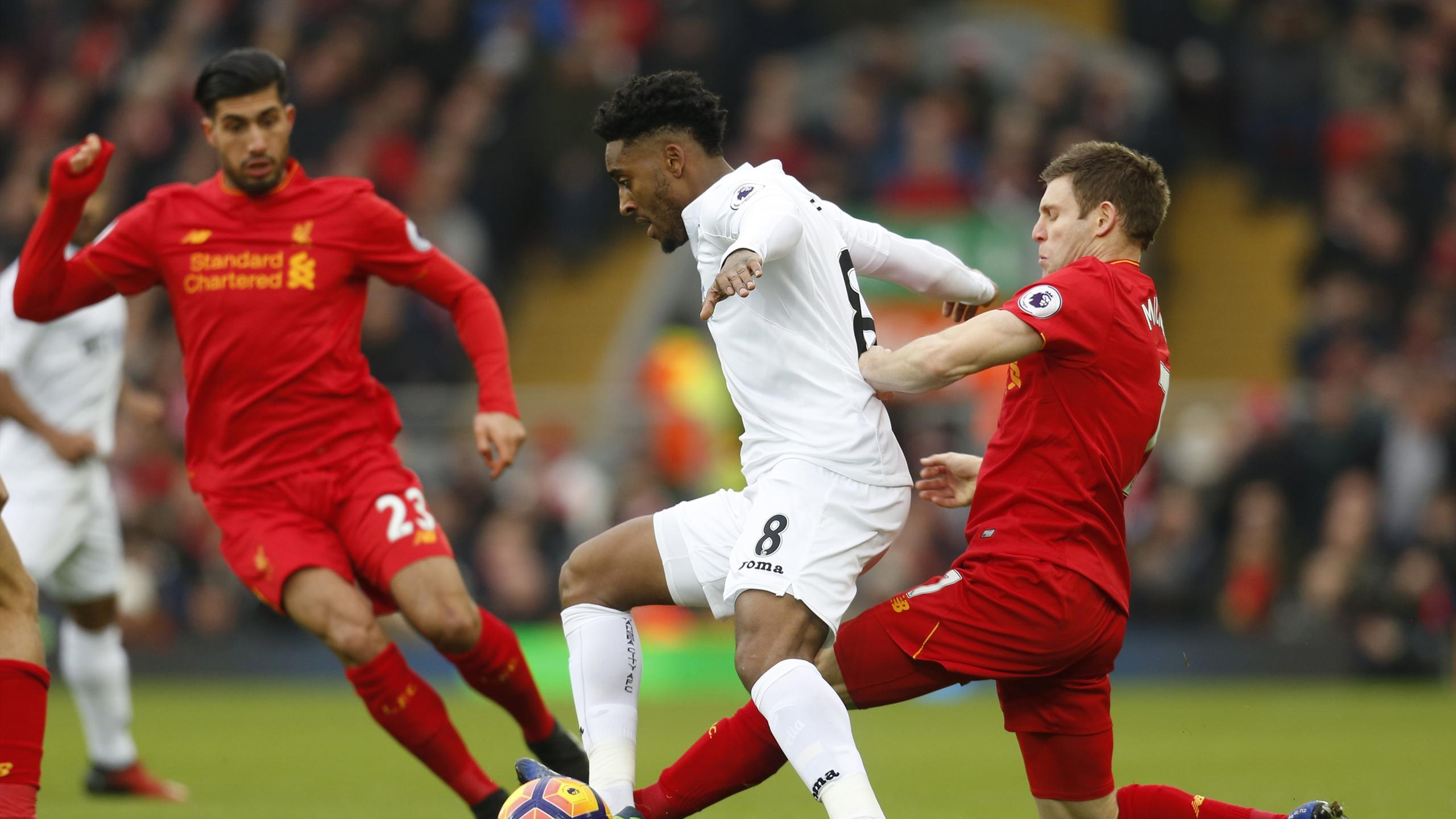 Swansea City's Leroy Fer in action with Liverpool's James Milner