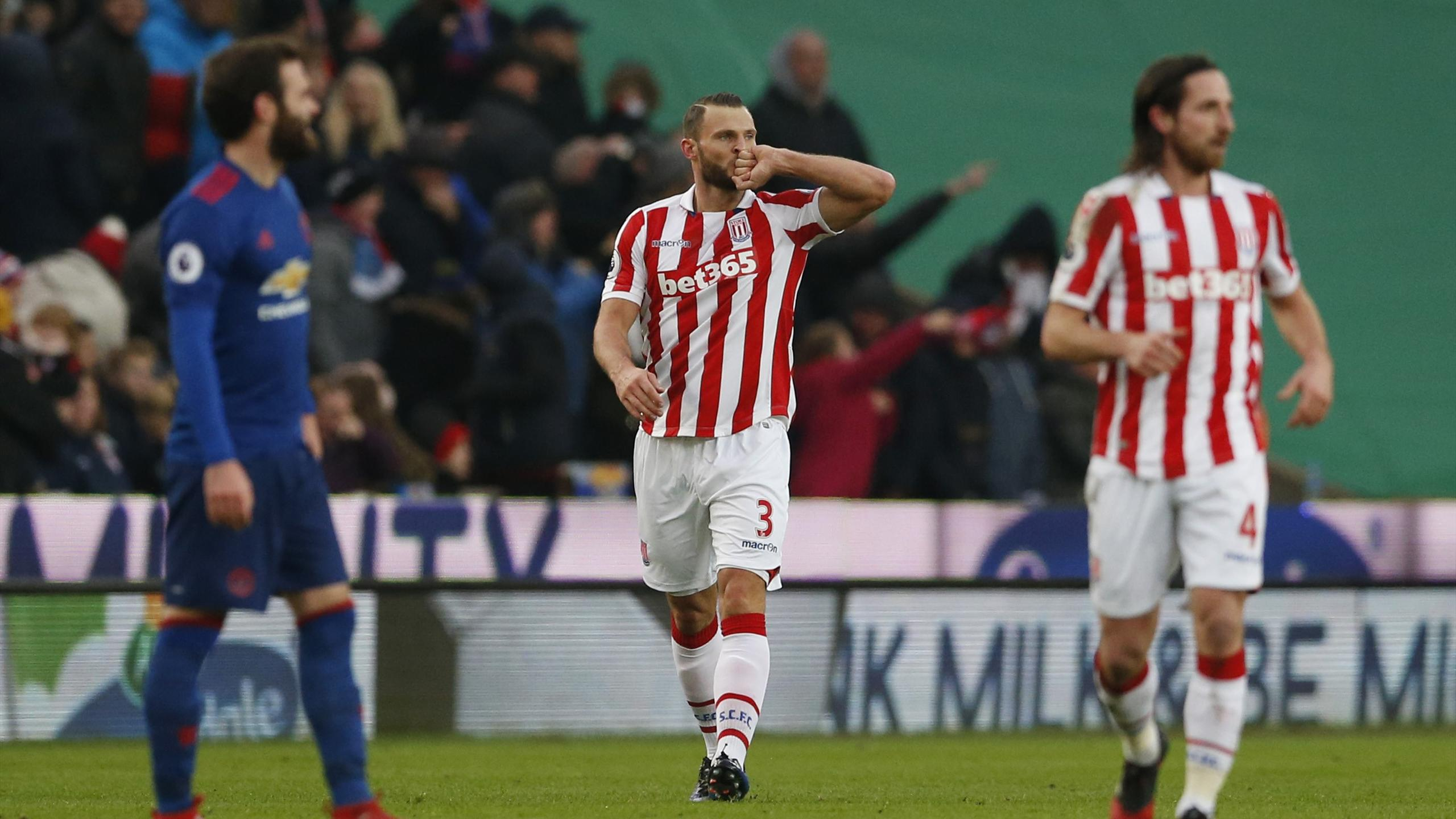 Stoke City's Erik Pieters celebrates after his cross is deflected by Manchester United's Juan Mata