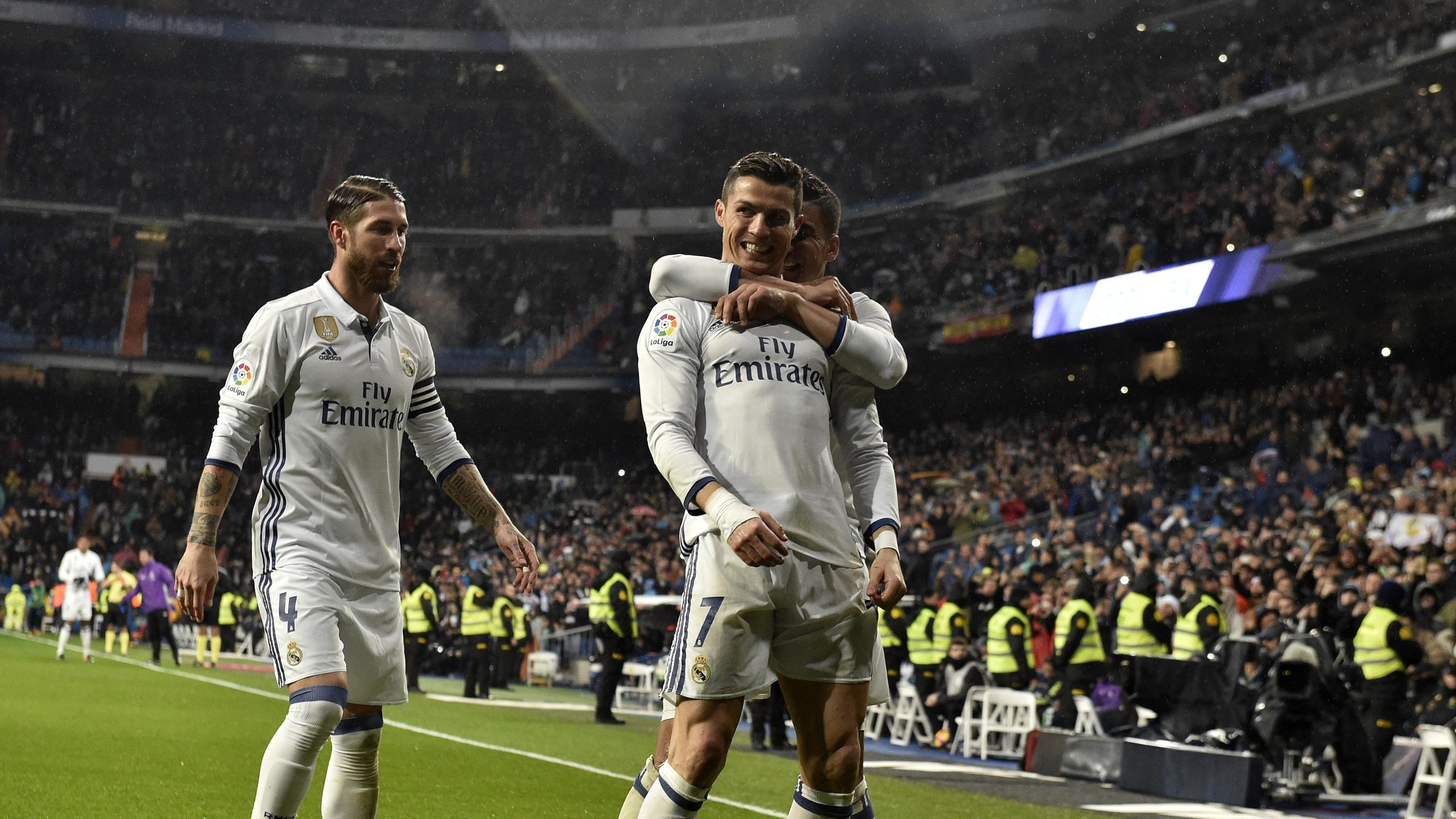 Real Madrid's Portuguese forward Cristiano Ronaldo (C) is congratulated by Real Madrid's defender Sergio Ramos (L) and Real Madrid's Brazilian midfielder Casemiro after scoring a goal during the Spanish league football match Real Madrid CF vs Real Socieda