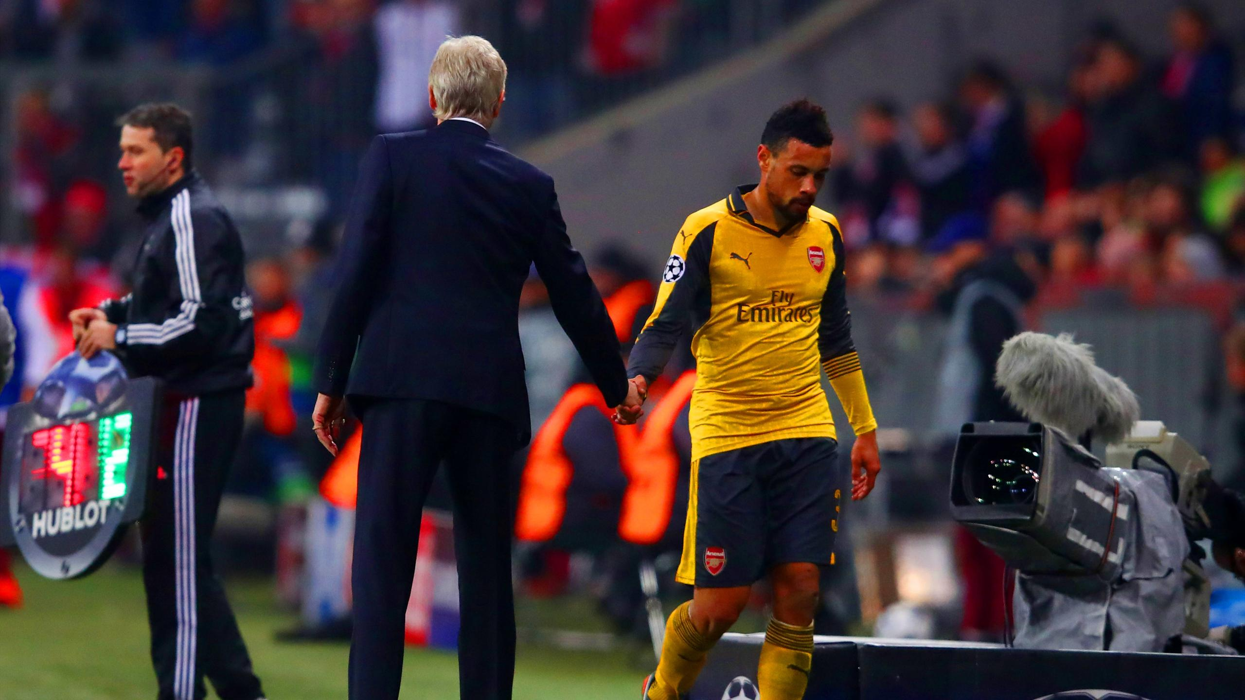 Arsenal's Francis Coquelin walks past manager Arsene Wenger as he is substituted