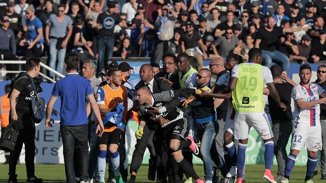 Bastia v Lyon called off as home fans invade pitch
