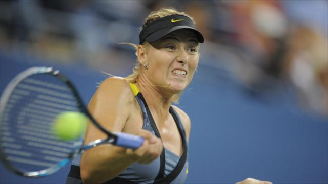 Sharapova grand slams Wozniacki after rival is eliminated