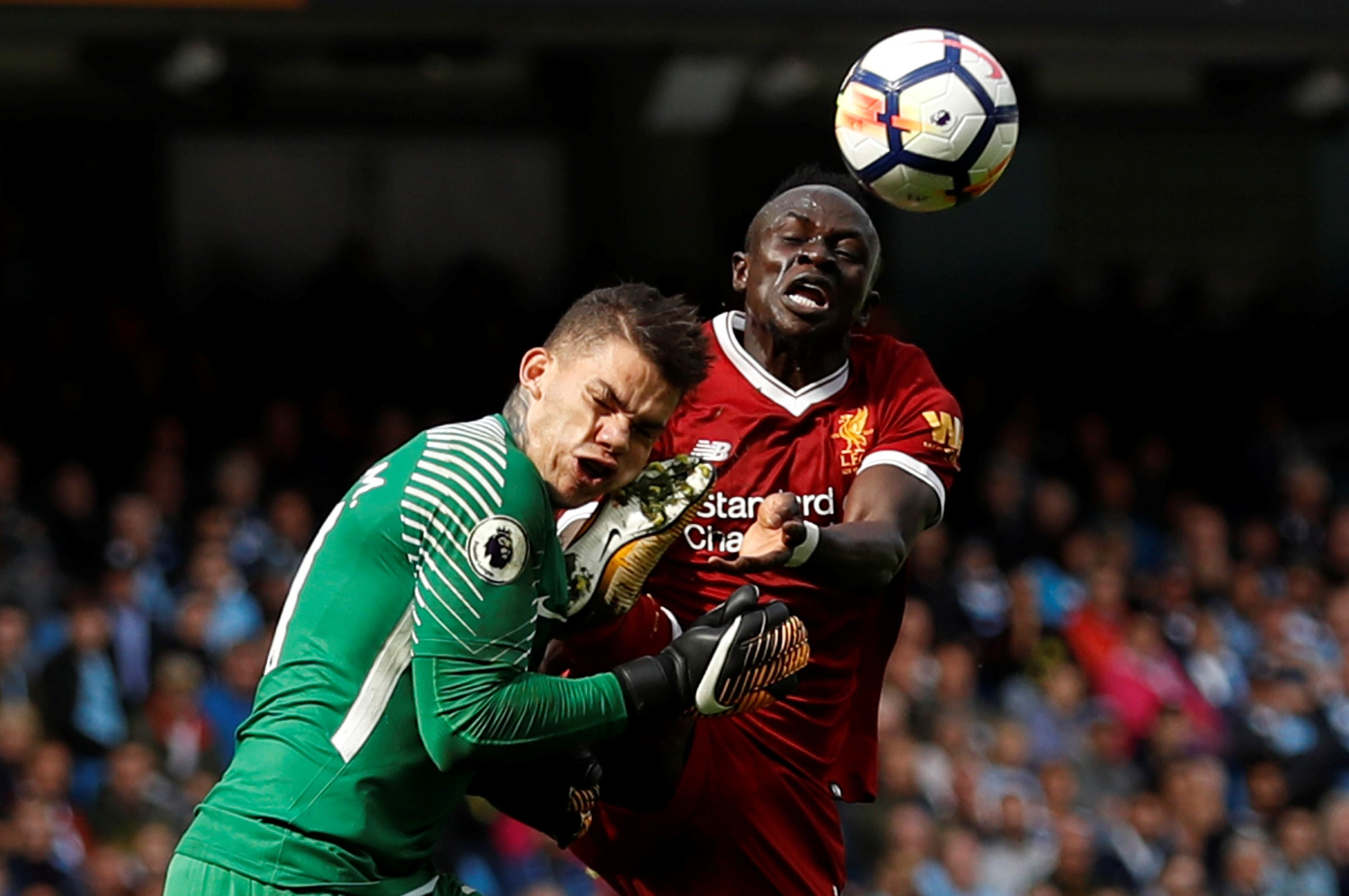 Manchester City's Ederson Moraes is fouled by Liverpool's Sadio Mane